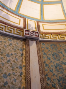 Interior walls, covered in floral fabric.