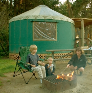 Here's the kids and me grilling up some hot dogs outside our yurt in Oregon.