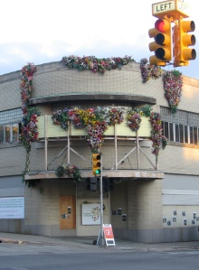 A building sprouts artificial flowers in downtown Grand Rapids.